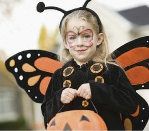 Using face paints instead of masks so kids' visibility is not compromised when trick-ortreating.