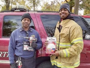 On-call firefighter Haskel Walker and firefighter trainee Bennie Griggs were among those making the rounds in a door- to-door safety campaign to install smoke detectors.