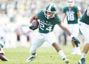 Carman-Ainsworth grad Gerald Holmes carries the rock for the Michigan State football team. Holmes has earned the starting running back position after starting the season at No. 3 on the depth chart.