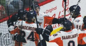 Flint players celebrate another goal against Erie on Sunday at the Dort Federal Event Center.