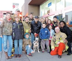 Firefighters, their families and Buddy the Dalmatian, spent 12 hours in front of the Wal- Mart store on Saturday collecting toys, clothing and money for the Salvation Army Red Kettle drive.