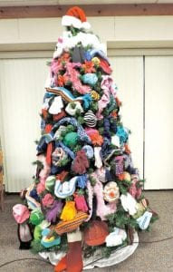 Items decorating the annual AFSCME Clerical Union's Hats, Scarves and Mitten tree will be distributed before Christmas to children attending Flint Township schools. Additional donations are being accepted at the township hall.