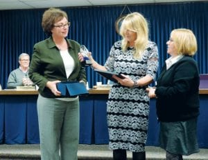The township board honored longtime employees Ronna Gettel and Mark MacDermaid, who are retiring.