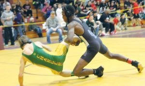 Carman-Ainsworth's Elijah Brandon (right) takes down Midland Dow's Jacob Sweet in a 103-pound match at the Genesee County Tournament last Saturday at Davison.