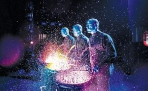 Members of the Blue Man group performing.