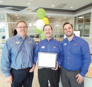 Left to right: Matt Stevens, General Manager; Richard Canever, Pres. and CEO; Jeff Canever, Sales Manager at Vic Canever Chevrolet display the Green Dealer Program Award that was awarded to them by General Motors.