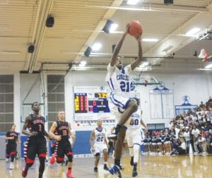 Carman-Ainsworth's Omari Duncan, here breaking away for a layup in the season opener, led the Cavs with a game-high 19 points against Flushing on Tuesday.