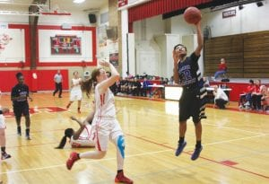 Carman- Ainsworth's Chelsey Carpenter puts up a shot during a game last month.
