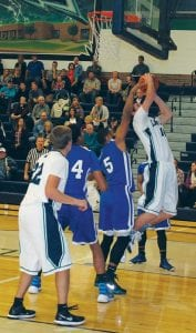 Jaylen Bradley (5) blocks a shot during the first half of the games at Lapeer.