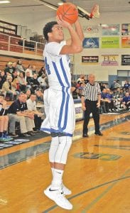 Michael Fletcher takes a jump shot for Carman-Ainsworth at home last Friday against Lapeer.