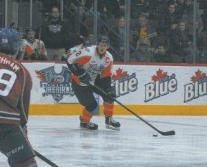 Flint's Vili Saarijarvi skates the puck past several Sarnia defenders.