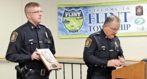 Flint Township Officer Michael Schuyler, who was shot during an incident a year ago, was one of 13 law enforcement officers recognized last week for outstanding professional conduct at the shooting scene.