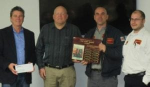 Goyette Mechanical Technician Roger Stanley (holding award) is presented with the 2015 Curt Maser Award for Excellence in HVAC Service. Presenting the award are Goyette Mechanical General Manager Curt Lalonde (center left) Supervisor Nate Leonard (right), and company President Dominic Goyette (left).