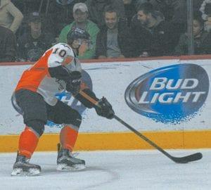 Flint's Nicholas Caamano kicks the puck back to his defensemen.