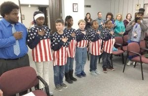 Six Dye Elementary fifth-grade students received special recognition from the Carman- Ainsworth School Board for their efforts as flag raisers.