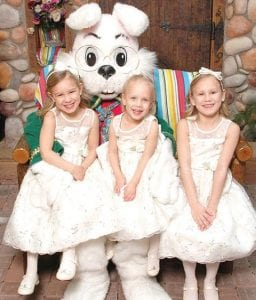 Children dressed in their Sunday best come to the mall's Bunny House at center court to take a photo with the Easter Bunny.