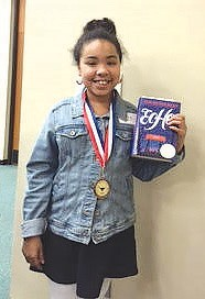 Morgan Wright, a sixth grader at CAMS, placed third in the countywide spelling bee for sixth-graders.