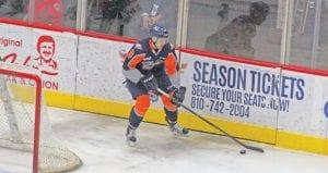 Flint's Alex DiCarlo gains control of the puck behind the Firebirds' net.