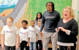 Dallas Cowboys cornerback Brandon Carr and Community Laision Sheena Satkowiak encourage Dye Elementary third-graders to push it to the limit during one of the activities inside the gym.