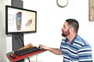 Derek Nowak, 40, of Grand Blanc has forged a career from helping those with foot and ankle problems. From athletic injuries to congenital defects, Nowak creates custom pedorthics, or arch supports and shoe modifications to help improve stance, gait and more.