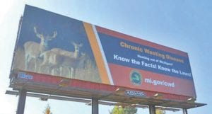 Billboards along Michigan highways point out the presence of chronic wasting disease in the deer population. Two more cases in the state were confirmed recently.