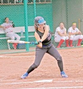 Carman-Ainsworth's Mikaila Garrison steps into her swing in a game against Swartz Creek last season.