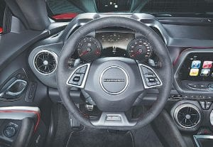 The driver-focused interior of the Camaro ZL1 features standard Recaro front seats, along with a sueded flat-bottom steering wheel and shift knob.