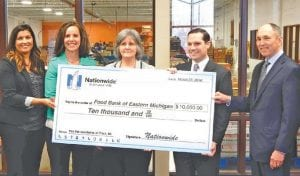 Cathy Blankenship, the Food Bank's Development Director, accepted the check from Angie Cutler, Nationwide Insurance Sales Director; Beth Horning, Nationwide Insurance Sales Manager; Cort Niemi, Lighthouse Group Area Director; and John Racine Lake Agency President.