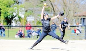 Carman-Ainsworth's Madison Cox goes through her pitch motion against Lapeer in a rescheduled game from last week.