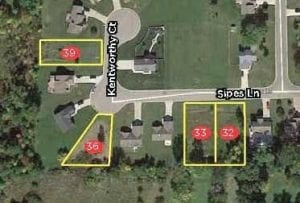Four vacant residential lots in the Bethel Woods Park Development off West Court Street will be auctioned off next week.