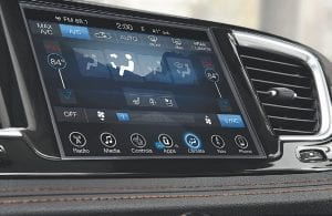 The Uconnect touch screen – available as either a 5-inch or 8.4-inch – is set flush with the instrument panel for a clean, technical look.