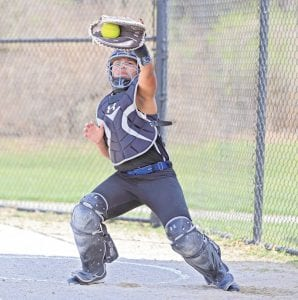 Catcher Jada Black hauls in the ball for the Cavaliers during an April 19 game.