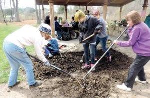 Replanting flower beds was one of the tasks undertaken by volunteers.