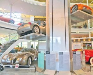 Chrysler vehicles old and new are part of a display in the two-story atrium of the three-level Chrysler Museum.