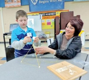 One hands-on challenge was to figure out the best shape to build a structure using spaghetti straws and marshmallows. This young man figured out that a triangular shaped was sturdier than a square one.
