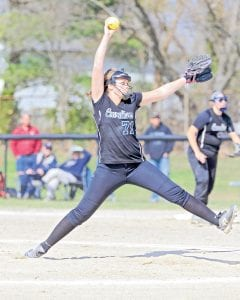Carman-Ainsworth's Madison Cox delivers the pitch.