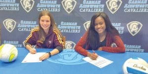Emily Johnson, left, and Sydney Cunningham put their names on national letters of intent Friday.