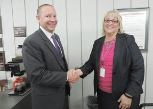 C-A Superintendent Steve Tunnicliff, who is resigning at the end of the month, congratulates newly hired assistant superintendent Cathy McGilvery at the C-A school board meeting last week.