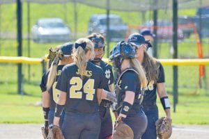 Lapeer and Genesee county rivals, now playing as teammates, huddled up at the pitcher's circle as part of the Mott Community College women's softball team that put together a record-breaking season in 2016.