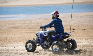 An off-road enthusiast rides the dunes along Lake Michigan's shoreline at Silver Lake State Park in Oceana County. Upcoming Free ORV Weekends – June 11-12 and Aug. 20-21 – offer riders the chance to explore Michigan's state-designated routes and trails, no permit needed.