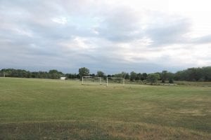 Left, the AYSO soccer field on Linden Road is featured in the June issue of Michigan Township Focus magazine.The redeveloped landfill is now a field of practice and play for AYSO soccer games from September through mid-June.