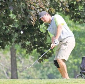 Flushing's Joe Montpas chips onto the green during Monday's opening week of the Flint Junior Golf Association season at Flint Golf Club.