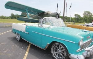 A Chevy Bel Air parked in front of a WWII-era plane at the Yankee Air Museum in Van Buren on Friday, June 10, the first day of the Promotional Friendship Tour.