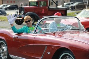 "Janet and Jerry Koryciak, of Davison, enjoyed their sixth Back to the Bricks event, waving to their fellow automobile enthusiasts from their 1962 Corvette, painted in its distinct ""Honduras Maroon."""