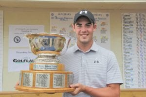 Jack Weller holds the Charles Kocsis Medalist Trophy he won in last week's Michigan Amateur at Eagle Eye Golf Club.