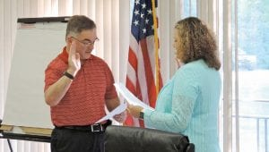 C-A Board President Patrice Hatcher issued the oath of office to Gary Cousins who was appointed last week to a vacancy on the school board.