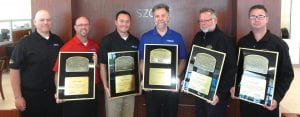 Steve Gabbara, John McLellan, Jr., Anthony Ketchum, Dave Prado, Rick Burczyk and Chris Boan display Szott Ford's President Awards. Ford Motor Company has recognized the Holly dealership for outstanding customer service for the last four years in a row and for five out the last six years.