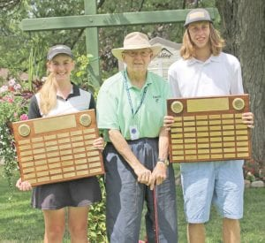 Brooke Thomas and Kyle VanBoemel hold the Henrickson Award plaques they won Monday at Atlas Valley Country Club. The plaques were presented by Bill Hense, supervisor of the Jack Nicklaus Group in the Flint Junior Golf Association.