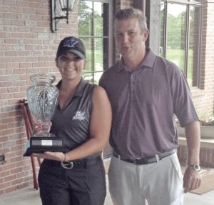 Julie Guckian stands with Doug Brody, PGA Pro at Warwick Hills Golf and Country Club, after winning the Genesee Ladies Golf Classic on July 16.