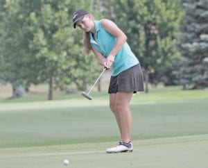 Flushing's Brooke Thomas putts out on the 18th hole at Spring Meadows Country Club on Monday. Thomas shot 73 to post the girls' low score in Flint Junior Golf Association play for the third time this season.